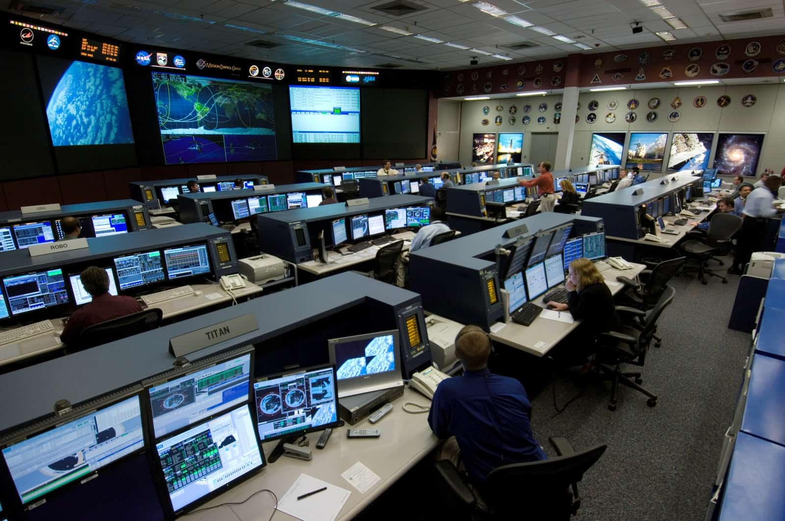 Large flight control room with computers and screens