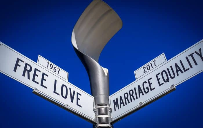 "Street signs with sky above, ""free love"" and ""marriage equality"""