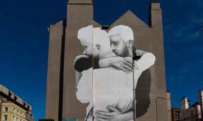 Gay men on wall