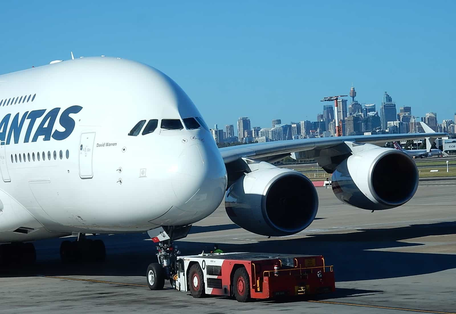A380 jumbo on runway with city in background