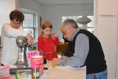 Grandparents and Grandchild in kitchen