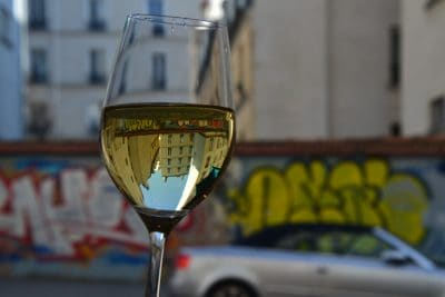 Wine glass with reflection of buildings