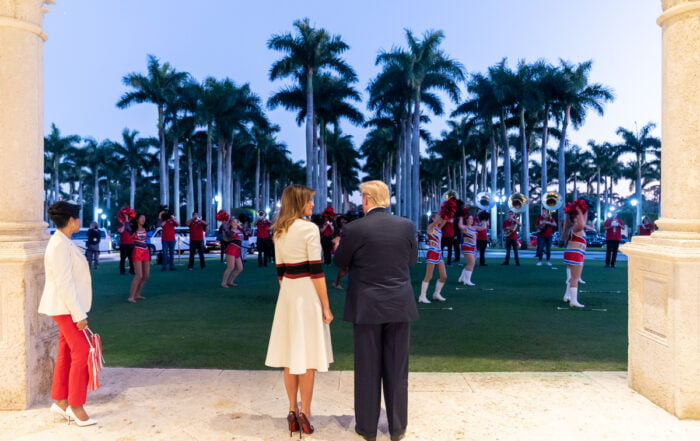 President Trump and Melania from behind in Florida watching cheerleaders